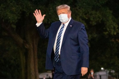 Trump 'reports no symptoms' of COVID-19, physician says