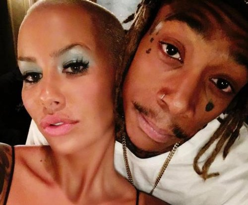 Amber Rose and Wiz Khalifa reunite, post photos on social media