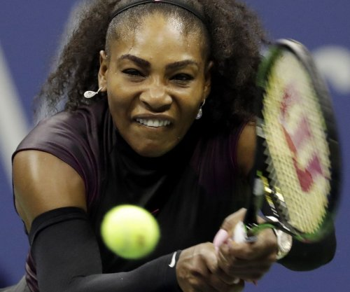 Venus Williams, Serena Williams easily advance at U.S. Open