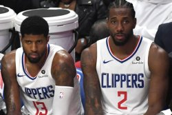George, Clippers spoil Lakers championship party with ring-night win