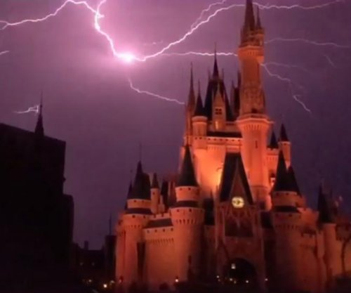 Lightning lights up Cinderella's castle, delays fireworks