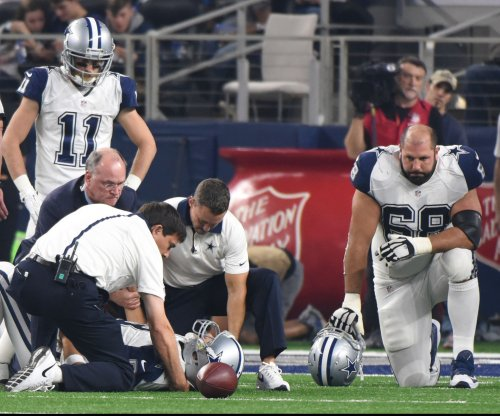 Tony Romo OK after giving Dallas Cowboys scare
