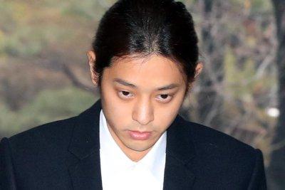 K-pop singer Jung arrested over sex video scandal
