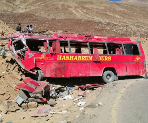 Bus rams into mountain in Pakistan, killing dozens