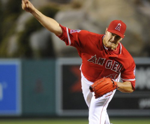 Cole Hamels pitches Texas Rangers past Los Angeles Angels