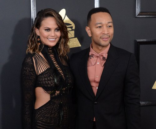 Chrissy Teigen, John Legend play Toilet Trouble after Grammys