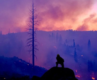 California crews report progress fighting year's largest U.S. wildfire