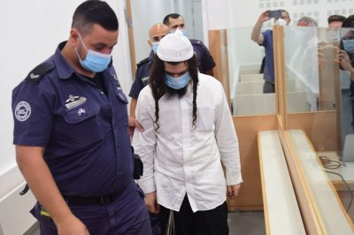 Israeli man gets 3 life sentences for killing 3 in Palestinian family