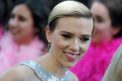 Scarlett Johansson shines in silver at 'Rough Night' premiere