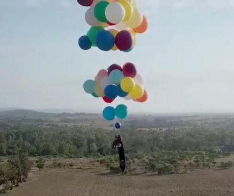 Daredevil flies over South Africa in camping chair attached to balloons