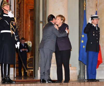 Germany's Merkel vows more support for France against Islamic State
