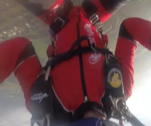 Sky diver drops camera at 3,000 feet, makes lucky catch with legs