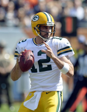 Vikings move on without Peterson, host red-hot Aaron Rodgers