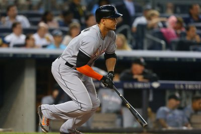 Giancarlo Stanton helps Miami Marlins hand Chicago Cubs fourth straight loss