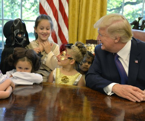Reporters' children trick or treat in Oval Office