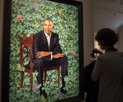 Portraits of Barack, Michelle Obama to travel on five-city tour