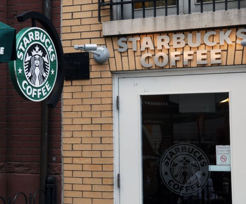 Starbucks holiday sales low, shares down 5 percent Friday