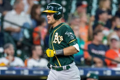 MLB playoffs: Athletics smack 5 homers, rally past Astros