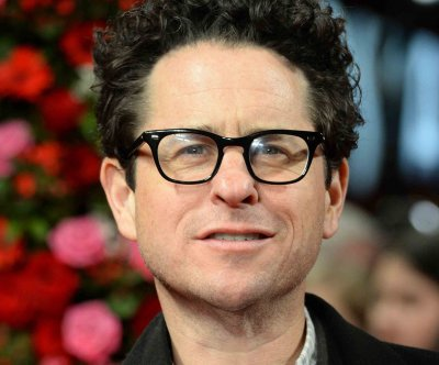 J.J. Abrams reveals he broke his back helping Harrison Ford during 'Star Wars' mishap