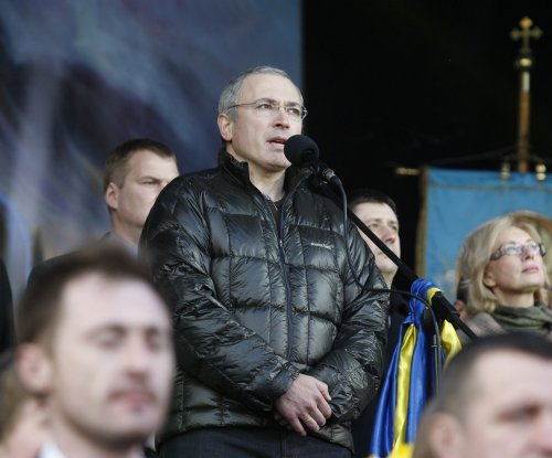 Russian police conduct raids linked to Mikhail Khodorkovsky probe