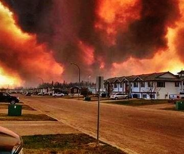 Massive wildfire forces evacuation of nearly entire city in northwest Canada; several homes torched