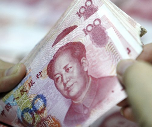Chinese yuan falls to six-year low against dollar