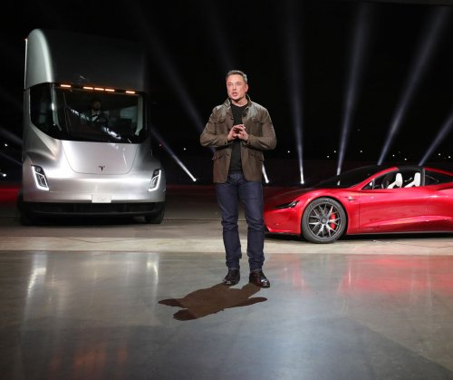 Tesla unveils electric semi-truck, new sports car