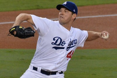 Dodgers set to debut Machado vs. Brewers