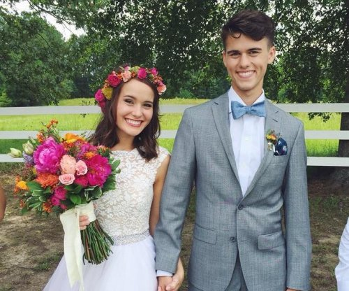 'Duck Dynasty' star John Luke Robertson weds Mary Kate McEacharn