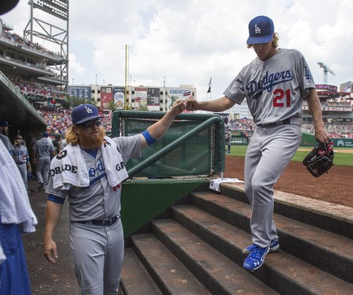 Zack Greinke helps himself at plate in Los Angeles Dodgers' 10-8 win