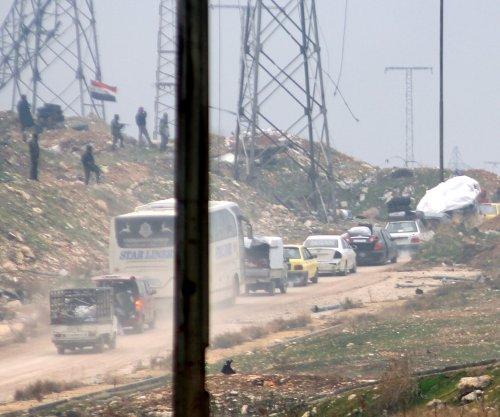 Aleppo evacuations resume after rebels burn buses