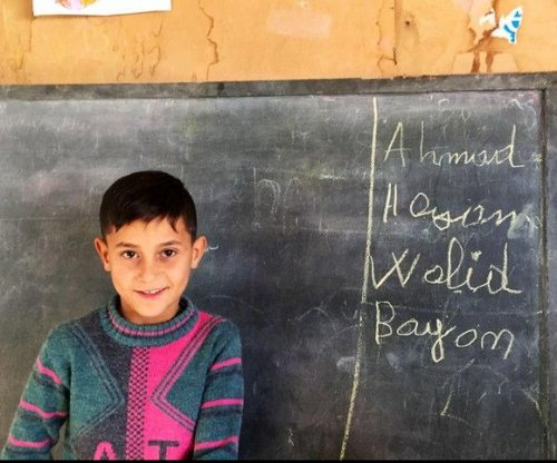 Living in shadows, Syrian refugee family tries to secure children's future