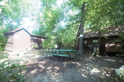 Wisconsin island for sale with two cottages, boathouse