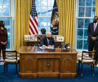Biden signs order allowing transgender Americans to serve openly in military