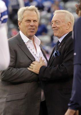 Cowboys hire Garrett as head coach