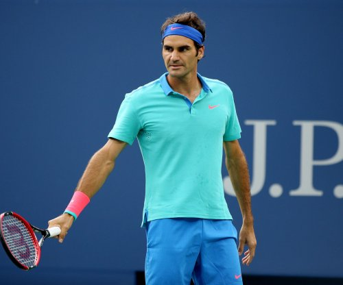 Federer reaches semis; Croatian teen stuns Murray in Dubai