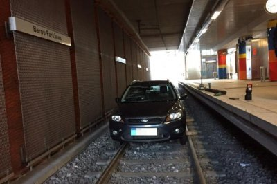 Man drives car on train tracks to underground station