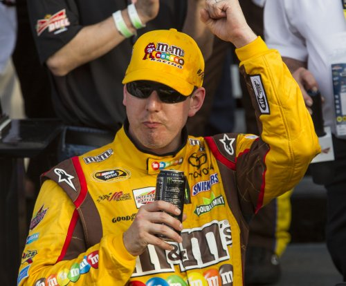 Kyle Busch passes Ryan Blaney on last lap to win The Brickyard