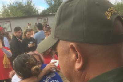 Separated immigrant families get brief hug at New Mexico border
