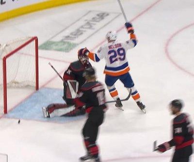 Islanders' Brock Nelson trolls Hurricanes' Curtis McElhinney with head pat
