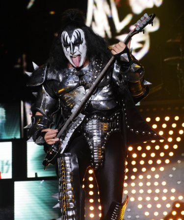Kiss star gets his tongue on rubber