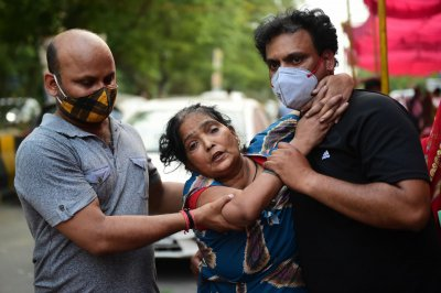 India reports record 401,000 COVID-19 cases in a single day