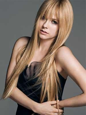 Avril Lavigne tones down her look in Allure make-under