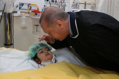 Erdogan visits site of building collapse where at least 18 died in Turkey