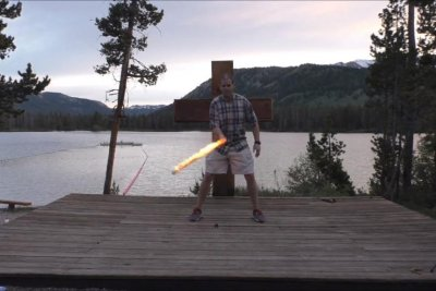 Man throws, catches fire sword 64 times in one minute for Guinness record