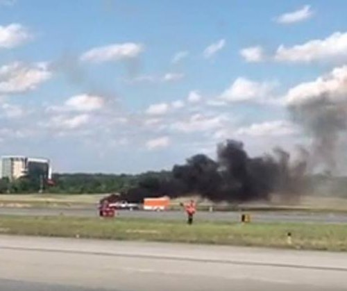 Stunt pilot killed when biplane crashes at Atlanta air show