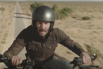 Keanu Reeves rides flying motorcycle in Super Bowl ad