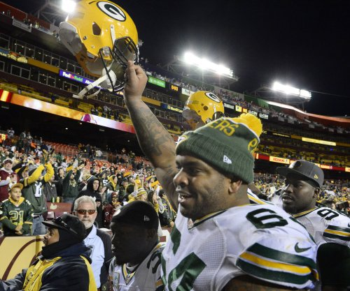 Green Bay Packers wake up to record playoff win