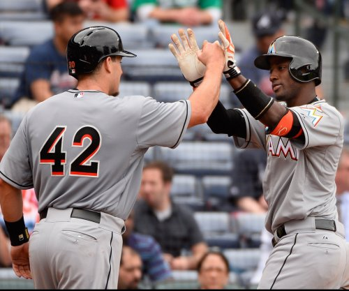 J.T. Realmuto is a real force as Miami Marlins edge San Francisco Giants