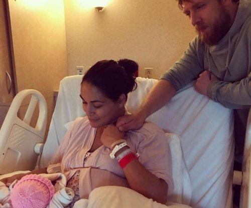 Brie Bella shares hospital family photo featuring newborn Birdie, Daniel Bryan